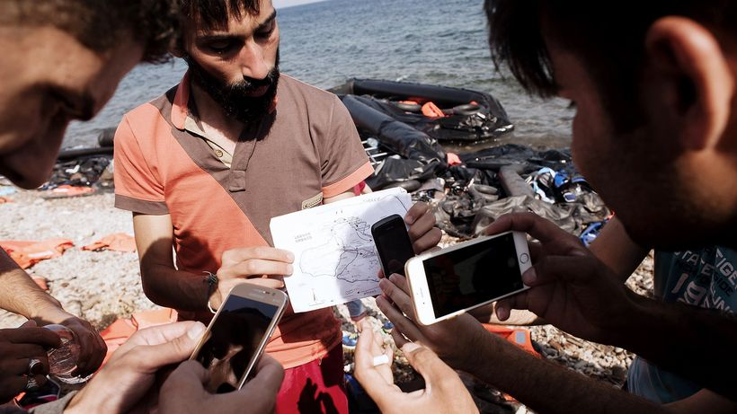 Refugees with smartphones.